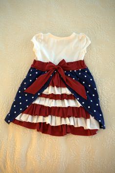 I know its for toddlers but imagine just the skirt and a white tank top!♥      DIY Red + White + Blue Bustle Dress #DIY #Sewing #Sew #Dresses #Kids #Toddlers #Baby #Babies #Clothes #BustleDresses #America #Flags #AmericanFlag #FourthOfJuly #MemorialDay #4thOfJuly