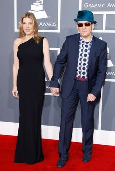 We're guessing he doesn't still have that other girl in his head anymore. Elvis Costello and wife Diana Krall arrive at the 54th GRAMMY Awards in 2012