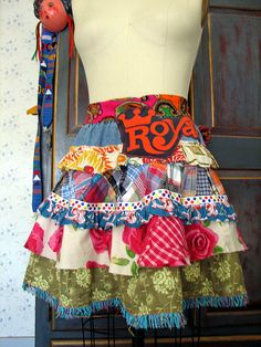Recycled apron made from skirts, old fabric, trim remnants, tshirt cutting, 60s psychedelic fabric tie.