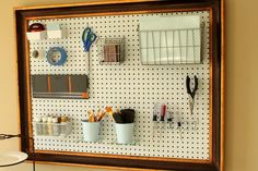 Framed peg board gives an upscale look and easy access to all of your craft tools or office supplies, from justagirlblog.com