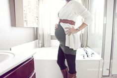 Tunic, sweater + belt on top, leggings and boots on the bottom. Cute.