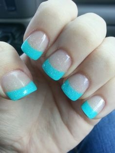 Aqua French tipped nails with some sparkles. Cute.