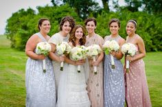 Mix and match bridesmaids dresses in blush/dusty pink, ivory and silver.