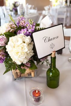 Cork and wine bottle inspired centerpiece Photo By Leah Marie Photography