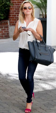 Reese Witherspoon elevated her day-time denim look with a crisp white blouse, skinny white belt, blue Celine tote and magenta heels.