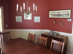 Beautiful Red walls in a dining room, accented by our mission style dining furniture.   Shown in the photo:  Classic Shaker Table with American Mission Style Dining Chairs. Both shown with Autumn Cherry Stain. Table: http://vermontwoodsstudios.com/products/boat-top-shaker-table Chairs: http://vermontwoodsstudios.com/products/american-mission-chair