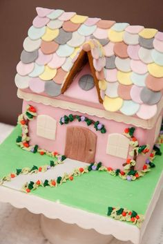Adorable dollhouse cake at a Paper Doll Birthday Party!  See more party planning ideas at CatchMyParty.com!
