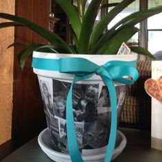 Mothers Day Flower pots!          1.Paint pots white 2.Print pictures on regular paper 3. Modge Podge pictures onto pot 4. Seal with clear acrylic paint pinterest-ideas-done