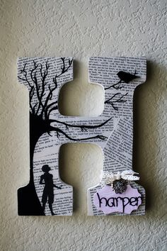 love this idea. book pages and tree w/name