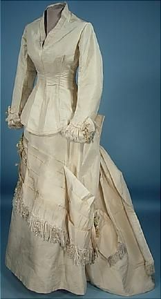 Circa 1875 Ivory Paper Silk two-piece Fly-Tie Silk Floss Fringe Bustle Wedding Gown with Original Decorations and Corset-Laced Back.