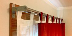 ikea hack, towel rack converted into drapes holder