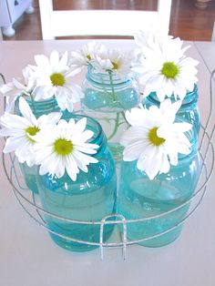 vintage mason jars and fresh daisies in a rusty canning basket