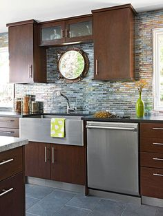 Family Friendly Porthole window and recycled glass backsplash in blue and golds