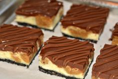 Hugs & CookiesXOXO: PEANUT BUTTER COOKIE DOUGH CHEESECAKE BARS ON AN OREO CRUST AND TOPPED WITH A MILK CHOCOLATE GLAZE!