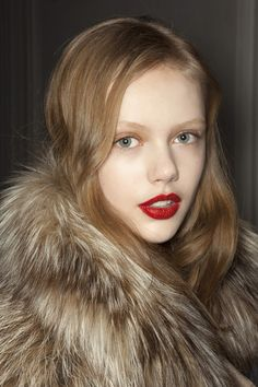 Fur & red lips.