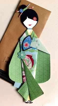 Origami green paper doll
