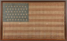 Large Framed Folk Art Forty-eight-star American Flag, early 20th century, composed of intricately folded coin wrappers