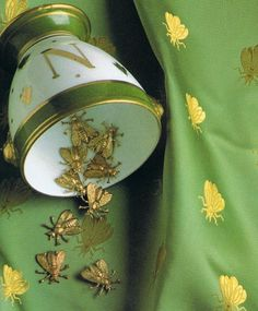 Green fabric, gold bees