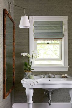 Santa Barbara Design House and Gardens Showhouse | Guest Bath featuring Graves Pivoting Sconce over the sink.