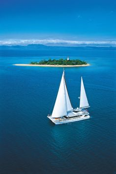Cruise to a beautiful reef island aboard a sailing catamaran. #australia