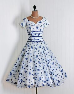 1950s Fashion at its Finest! party dresses, 1950s dresses, june cleaver, white, garden parties, day dresses, blues, falling leaves, 1950s fashion