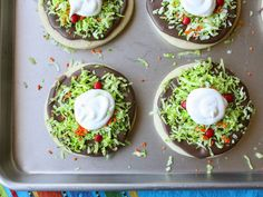 "The ""lettuce"" on these Tostada Cookies is just dyed shredded coconut, while the ""sour cream"" is white icing."