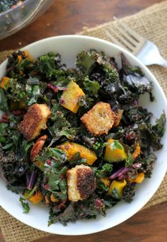 his kale salad makes for the perfect Thanksgiving side dish with its mix-ins of roasted squash, cumin-spiced pecans, brie croutons, and cranberry vinaigrette.