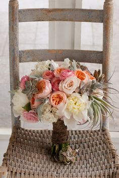 Rustic pink wedding bouquet with air plants, garden roses, ranunculuses, peonies, and succulents | Brides.com