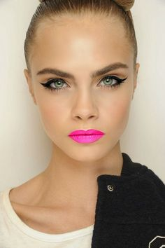 pink lips, winged eyes.