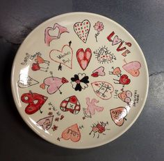 School auction idea: ceramic plate, each student makes a heart - source: ceramicafe, clackamas oregon