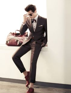 Suit, bowtie, no socks.
