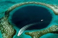 The Great Blue Hole is a submarine sinkhole off the coast of Belize. It's one of the top scuba diving sites in the world and the water is 407 feet deep- 27 Surreal Places To Visit Before You Die