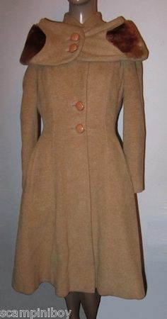"1940's coat made by Rensor of London ""The coat is made from a very heavy wool and mohair blend in camel and is single breasted with original large caramel coloured bakelite buttons. It has an amazing stole/wrap that is attached to the back and made of soft thick lambswool with wool/mohair backing and trim and fastens at the front with two chunky buttons. The coat has shoulder pads, two streamlined hip pockets."" via eBay"