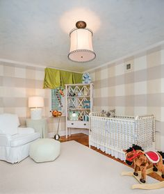 Nursery with hand painted gingham walls inspired by Peter Rabbit. Photo by Beau Kester
