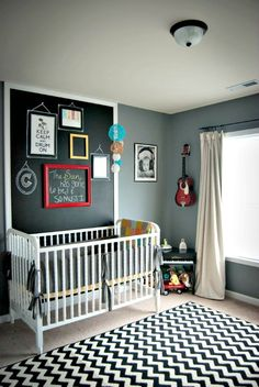 wall vignette of art and chevron rug