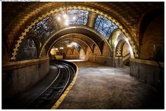 NYC's City Hall Subway Station was first constructed over 100 years ago, a part of New York's earliest underground transport network.  It has been shut down and untouched since 1945.  Incredibly beautiful!