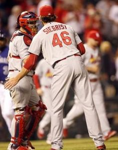 Relief pitcher Kevin Siegrist celebrates with catcher Yadier Molina after the game against the Rockies.  Cards won the game 11-4.  9-17-13 cardin crazi, games, cardin nation, card crew, hot shot, colorado rocki, stl cardin, stloui cardin, cardin basebal