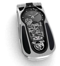 This rocks...mechanical watch plus mobile phone. Please build it!