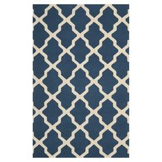 Hand-tufted wool rug with a Moroccan trellis motif in navy blue and ivory.  Product: RugConstruction Material: 1...