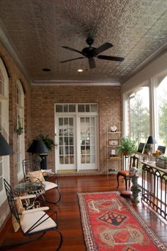 interesting idea. Raise the roof height and add a tin ceiling - screened porch
