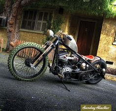 South Bay Bobber - Christian Ferreira 1952 Harley Panhead. Photo by: Johnny O Original 73-ci motor and four-speed transmission, green 21-inch front tire, while the 16-inch rear wheel, 1930's Model A taillight, DNA springer forks, and a leather solo seat, which was tooled with a skull design. Featured in issue two of Sunday Slacker Magazine