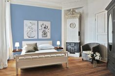 An otherwise whitewashed room gets a blast of calming blue (Daphne 27-8 from Pratt & Lambert) for restful sleep. | Photo: Courtesy of Pratt & Lambert | thisoldhouse.com paint color, placid blue, colors, wall paint, paint blue, white bedrooms, blue interior, blues, accent walls