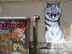 Street art stickers in Paris by the artist Rafael Suriani