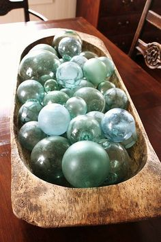 Vintage blue glass ornaments in a rustic bowl lovely decoration.
