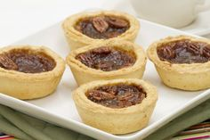 Petite Pecan Tarts: Just 103 calories each! A healthier way to enjoy your pecan pie without feeling guilty! | via @SparkPeople #recipe #dessert #treat #holiday