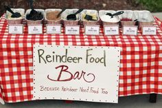 Reindeer Food Bar--a buffet of reindeer treats for the girls to choose from to make their own special blends for Christmas Eve (a tradition--you sprinkle it in your driveway Christmas Eve to lure the reindeer, and then they have something to munch on while Santa's in your house). Oats and raisins, bread crumbs and cocoa...and special ingredients like glitter and flying powder