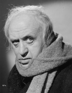 Alastair Sim as Ebenezer Scrooge