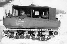 "In the other photo, the vehicle shown belonged to the Nebraska  National Guard and was assigned to taking my father and Mr. Hammond to the weather station because the depth of snow and accompanying snow drifts prevented driving U.S. Highway 30 (Lincoln Highway) east 3 miles to the airport.  The track vehicle was called a ""weasel""."