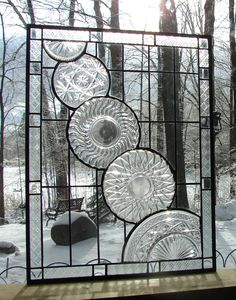 Crystal Cascade stained glass panel window. $195.00, via Etsy.    Neat thing to do with old crystal plates.