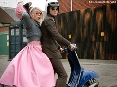 The suit, the Vespa and the girl on the back.